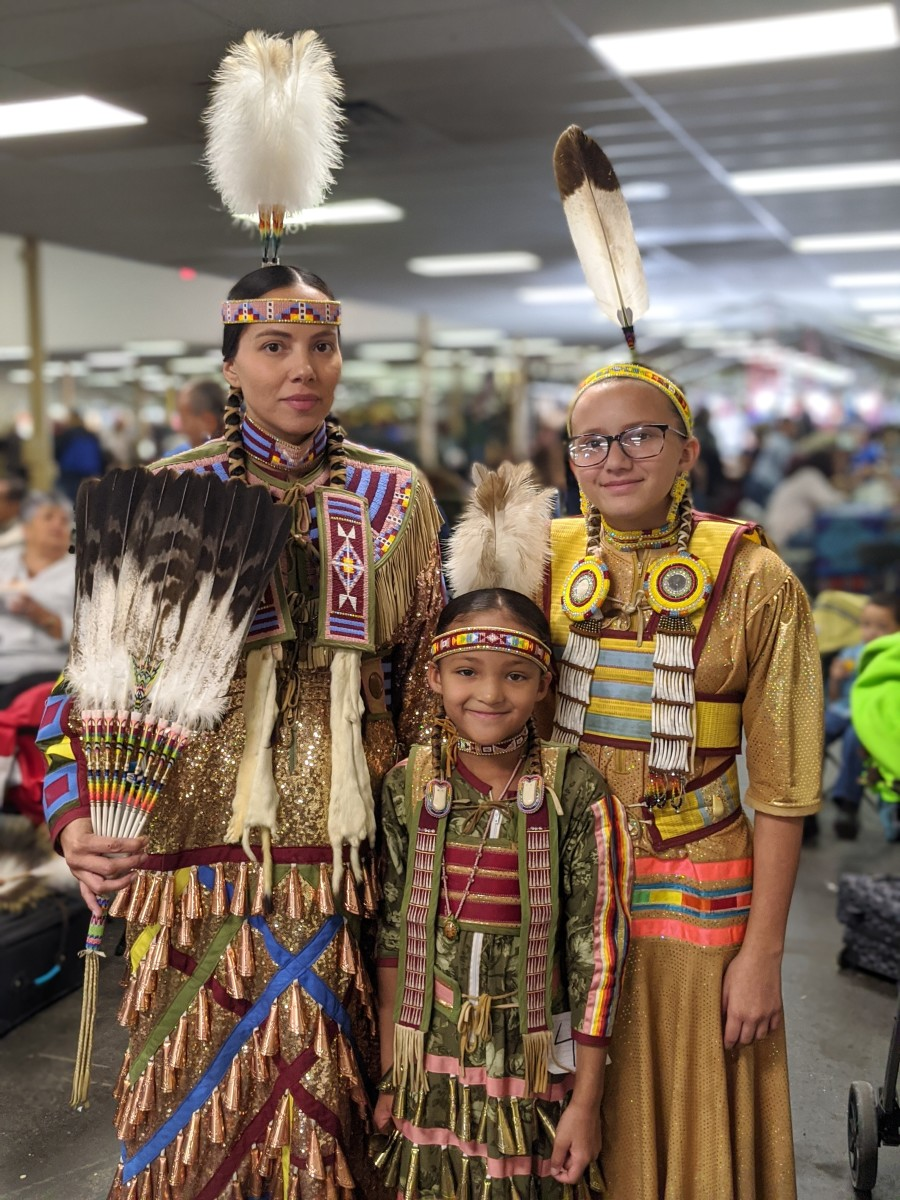 One of my favorite photos of the day. Erica Isennock, Rosebud Lakota, and her daughters Jaida and Mae (youngest In the center.) Photo: Vincent Schilling