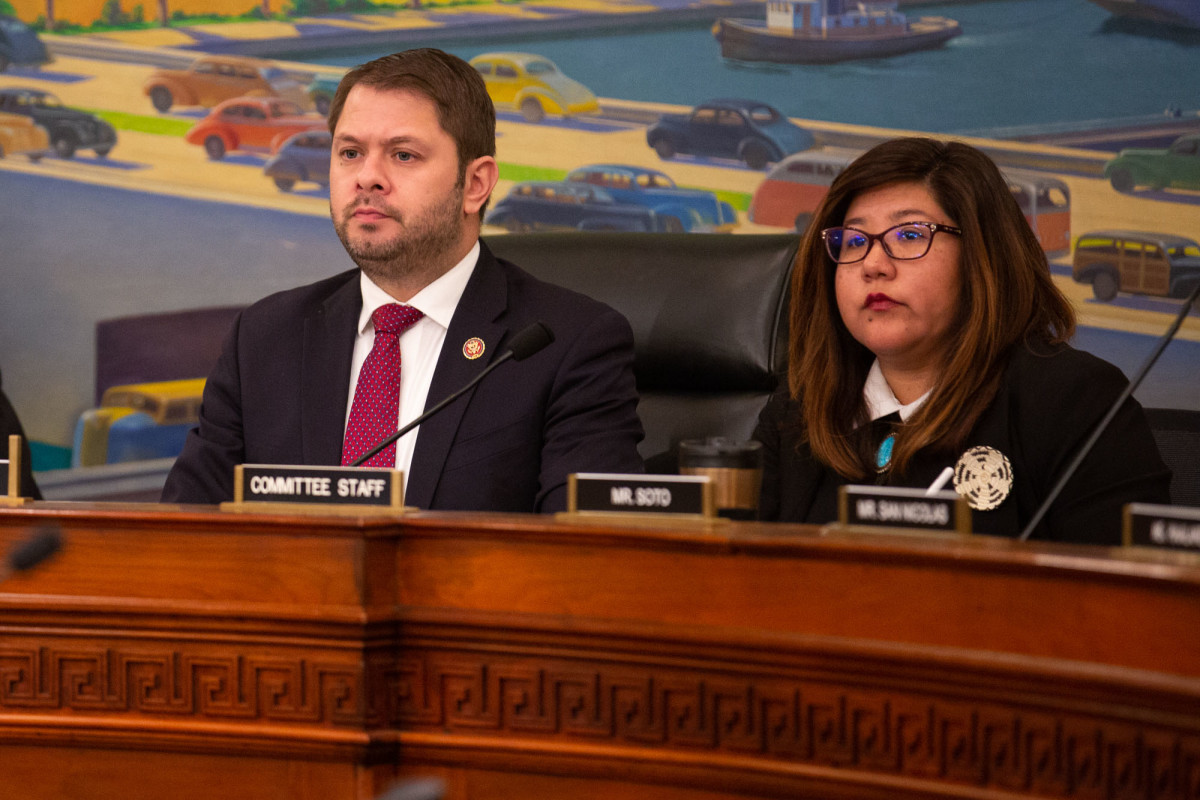 Rep. Ruben Gallego, D-Phoenix, and staffer Naomi Miguel listen at a House Natural Resources subcommittee hearing on the government's shortcomings in its support of Native American communities.