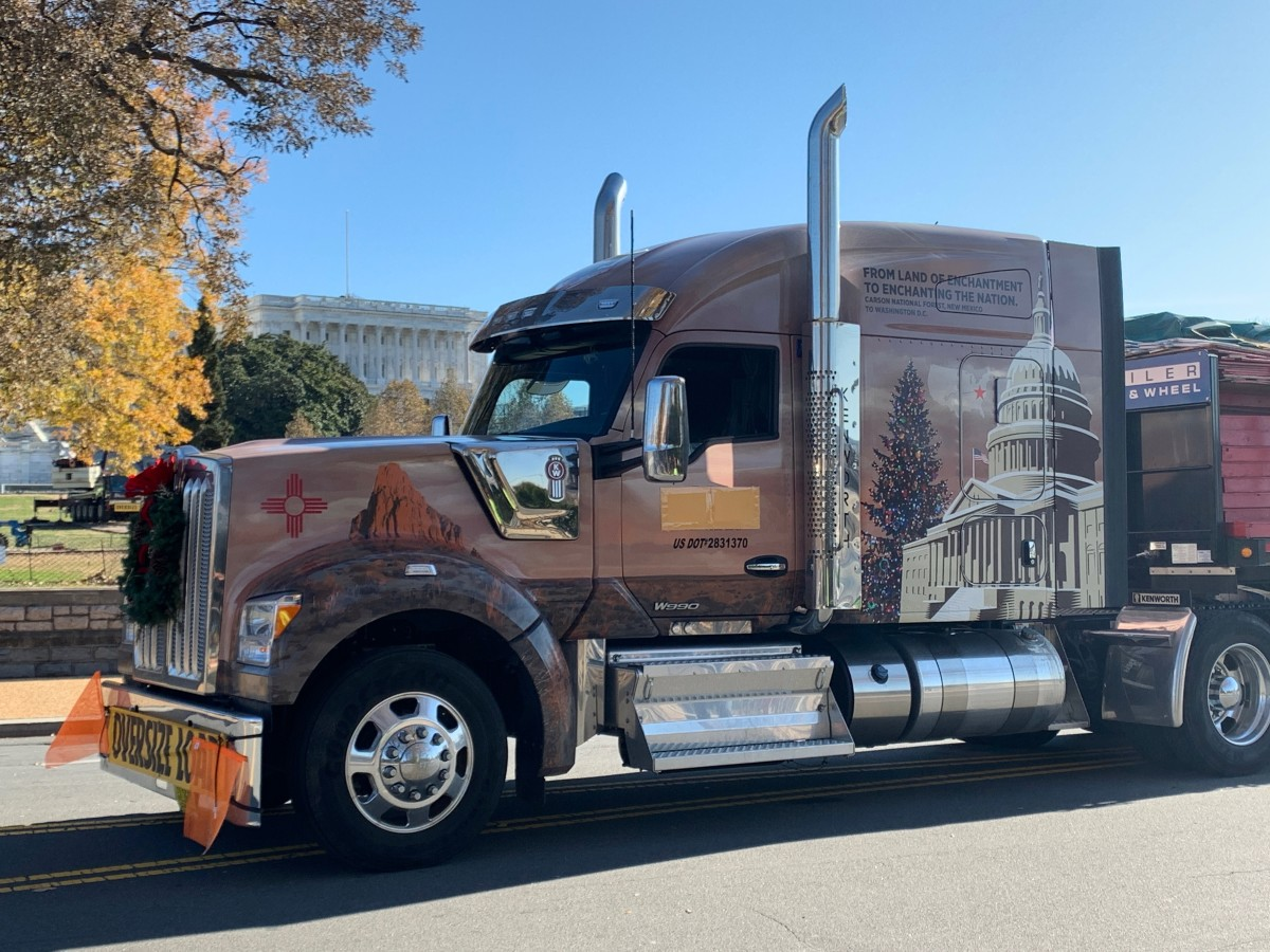 The truck that carried the tree and stopped in 30 communities across the country. Shiprock, the Zia symbol, and the Capitol are pictured on the truck.
