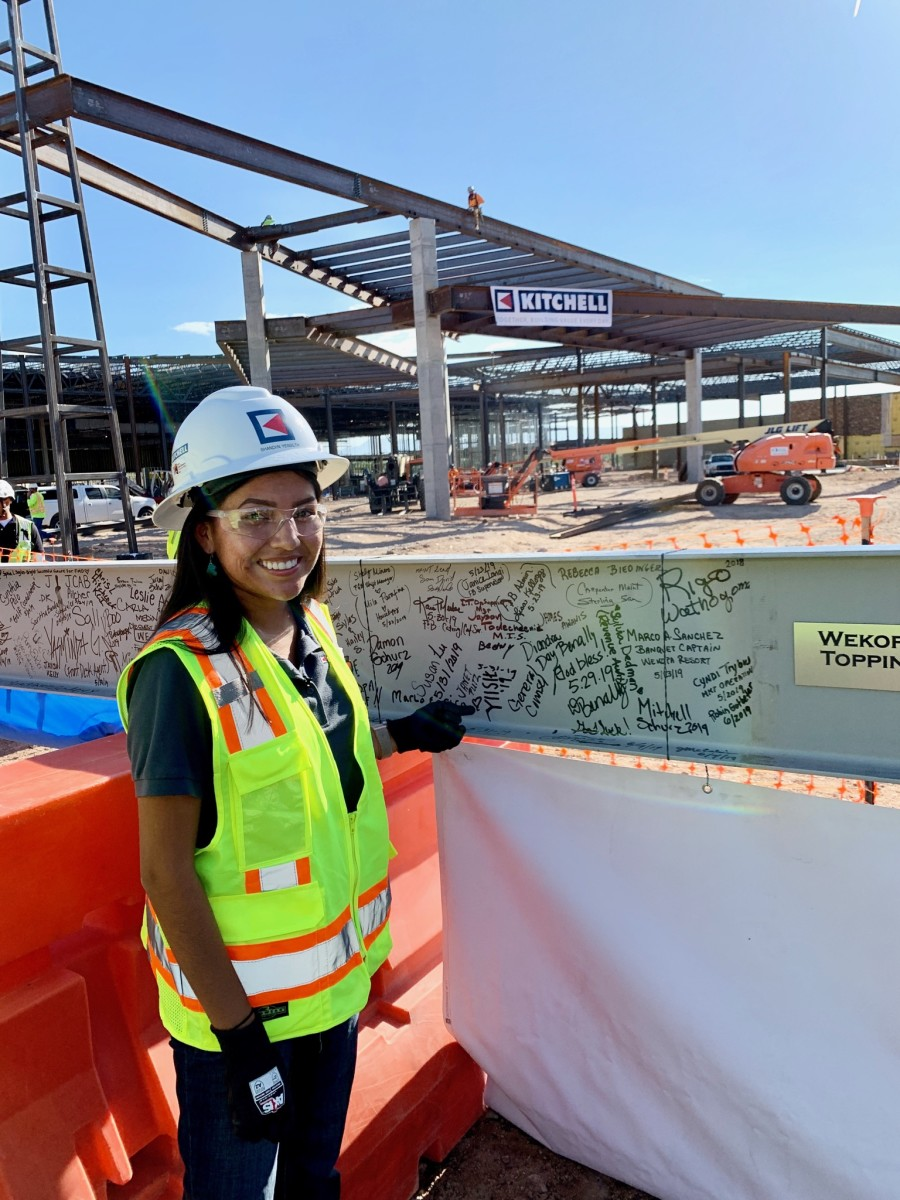 Shandiin Yessilth, Diné, is a mentee of Kim Kanuho who studies Construction Management at Arizona State University. She poses at a construction site near the Fort McDowell casino in Phoenix, Arizona where she interns with the Kitchell Corporation. She plans on pursuing a career in construction management in the future. Photo courtesy of Shandiin Yessilth.