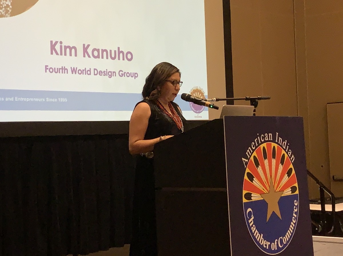 Kim Kanuho accepts an award for 2019 Business of the Year (Class 1) from the American Indian Chamber of Commerce of Arizona on December 6. Photo by Aliyah Chavez.