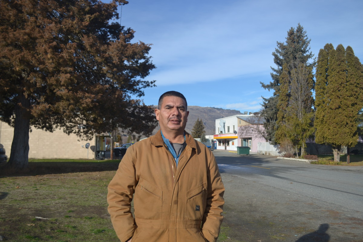 Manuel Farias, pictured outside his home in Bridgeport, said he was stopped three times in 2018 by state and local police in Okanogan and Douglas counties. Farias, a U.S. citizen originally from Mexico, said that in the Trump era orchard workers in the region, many of whom are immigrants, are afraid of police. (InvestigateWest photo)