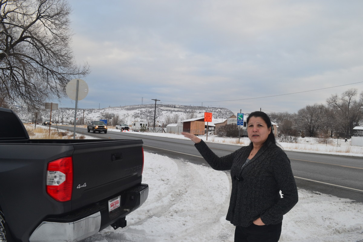 Norma Sanchez, a Colville Tribal Council member, points out where she says in 2017 she saw three state troopers stopping cars near where tribal land overlaps with the city of Omak in north central Washington. InvestigateWest's analysis found nearly one-third of all high-discretion searches of Native Americans by the Washington State Patrol happened where U.S. 97 entered the Colville and Yakama reservations. (InvestigateWest photo)