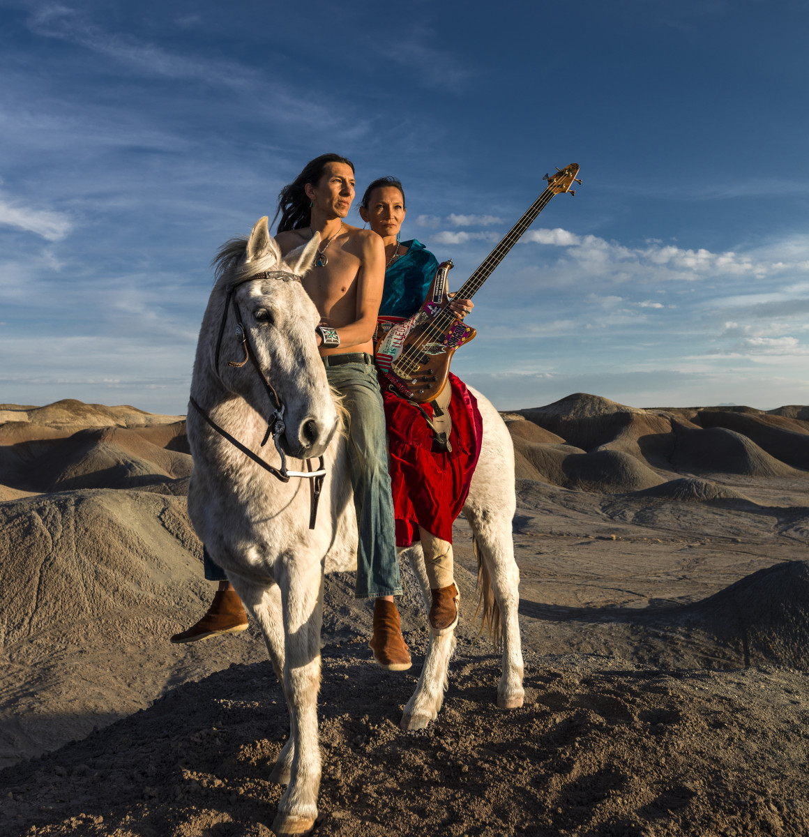 Navajo Punk rock band Sihasin is seen with their horse Moonshadow in a canyon in Cameron, Arizona. Sihasin comes from a long tradition of protest music and expouses traditional Navajo values to their audience. (Photo by Brent Stirton/Reportage for Le Figaro Magazine.)