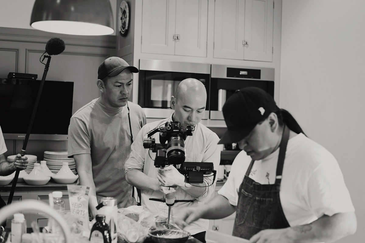 """Filmmaker Billy Luther, far left oversees the creation of """"alter-Native: Kitchen."""" Photo by Cybelle Codish."""