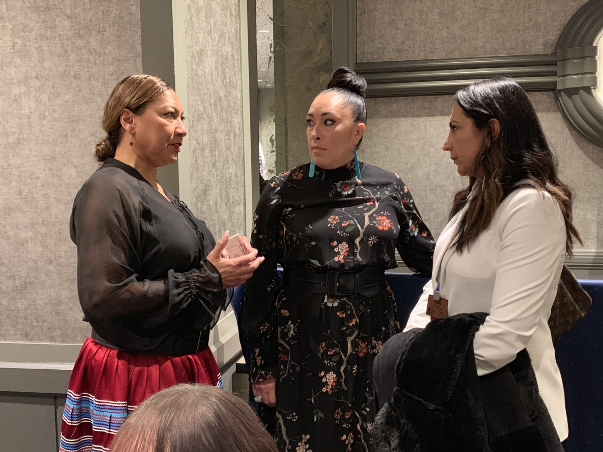 Crystal Echo Hawk (right) of the Reclaiming Native Truth Report speaks with other lunch attendees.