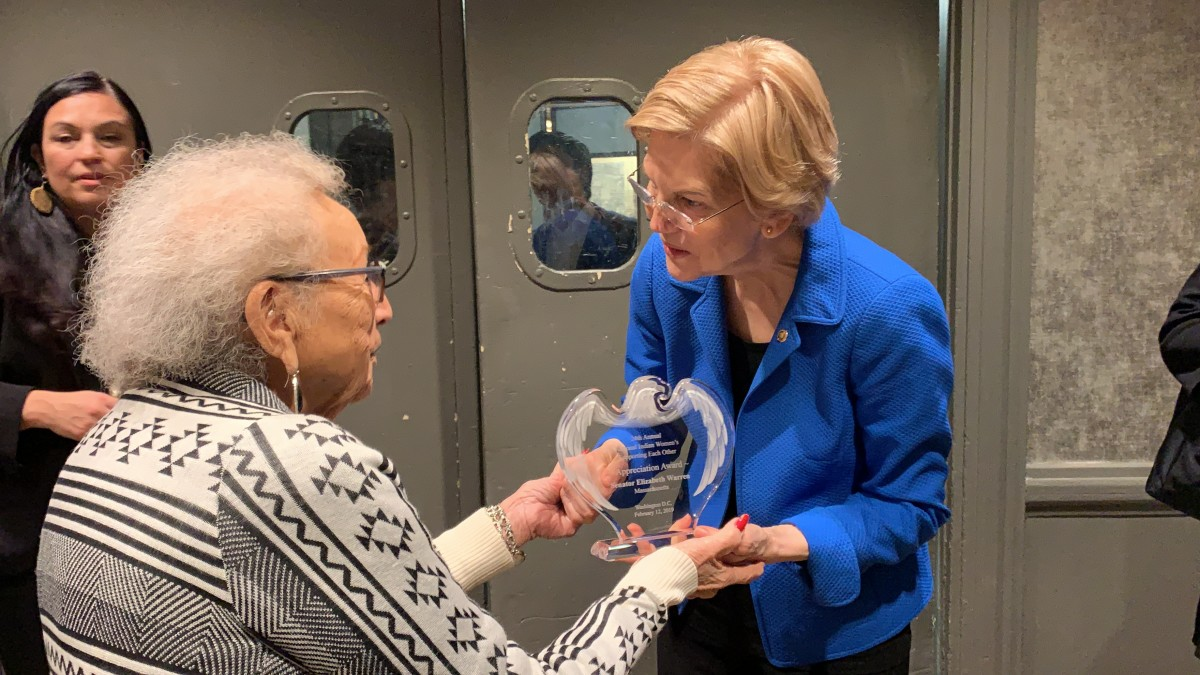 "Juanita Ahtone, Kiowa, gives Sen. Elizabeth Warren her ""Appreciation Award"" from the National Indian Women's 'Supporting Each Other' Honor Lunch on Feb. 12, 2019 in Washington, D.C."
