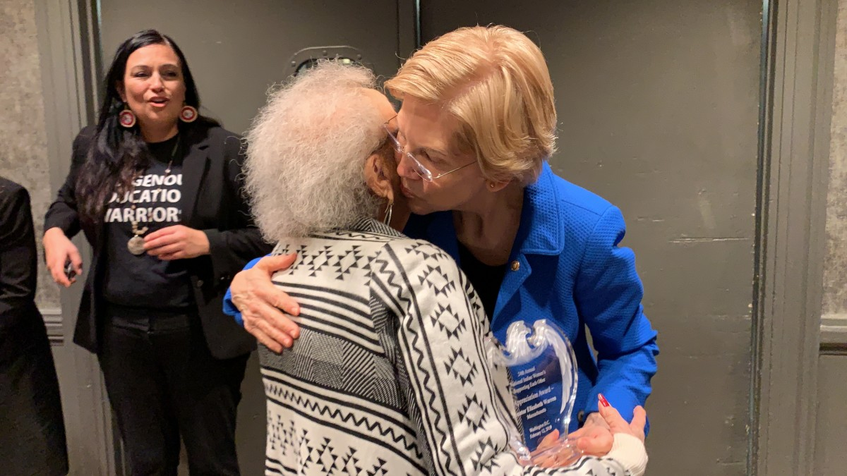 Sen. Elizabeth Warren thanks Juanita Ahtone, past honoree, for the award.