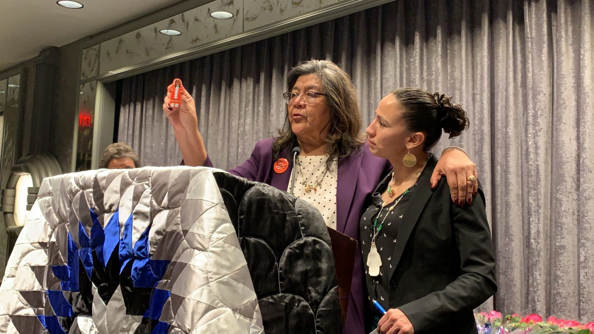 Cecelia Fire Thunder, Oglala Lakota, gifted Davids a beaded pin with a woman wearing a red dress to signify the missing and murdered Indigenous women.