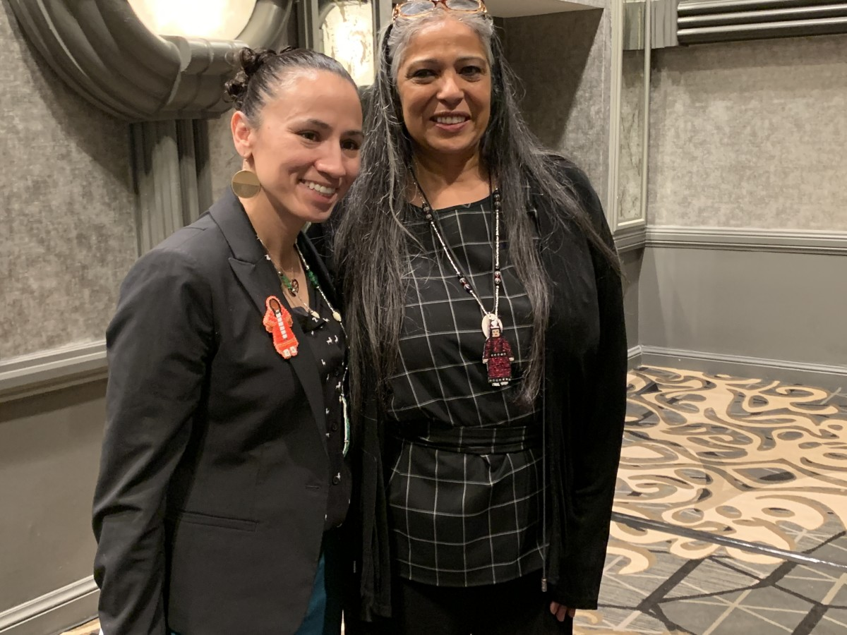 Women of the Year, Sharice Davids and Cheryl Andrews-Maltais, pose for photos after their speeches and awards.