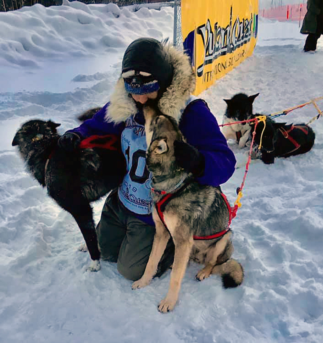 Martin Apayauk Reitan and his team celebrate Feb. 13 after crossing the finish line in the Yukon Quest. Reitan finished 14th and won Rookie of the Year honors. Reitan is a rookie to watch in the upcoming Iditarod Trail Sled Dog Race, which begins March 2 in Anchorage. (Courtesy of Ketil Reitan)