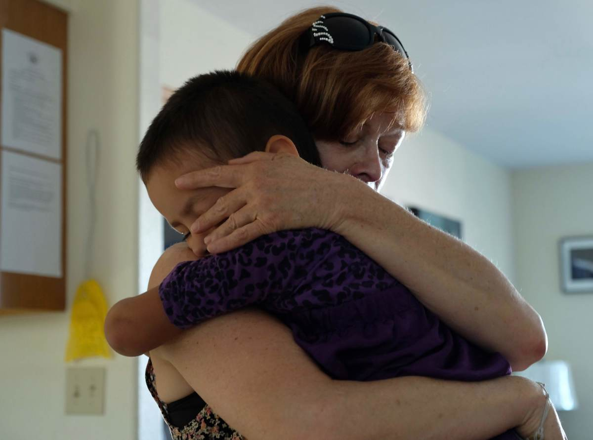 Film star Frances Fisher holds unknown child during True Sioux Hope Foundation 2017 tour of children's Safe Home. (Photo by Mary Annette Pember)