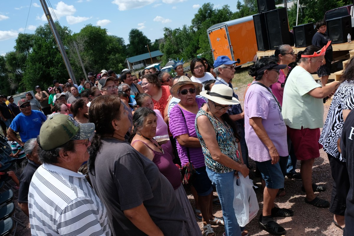 People in town of Pine Ridge on Pine Ridge reservation wait in line to receive donations from True Sioux Hope Foundation July 2017. (Photo by Mary Annette Pember)