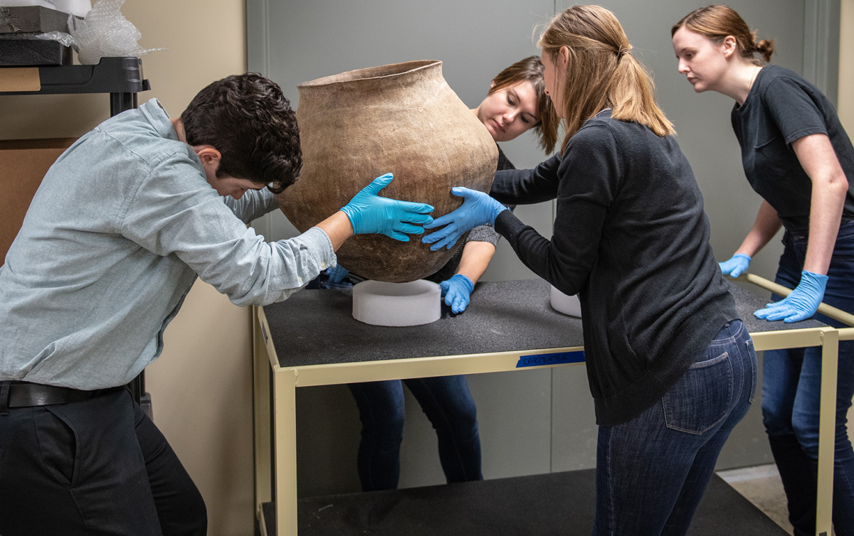 Museum studies graduate students from Indiana University-Purdue University Indianapolis (IUPUI) help care for the recovered artifacts in a facility near Indianapolis where all the recovered artifacts are housed securely and temperature, humidity, and light levels are controlled. Students and highly trained IUPUI staff also help prepare the artifacts for shipping when repatriation occurs. (Courtesy FBI)