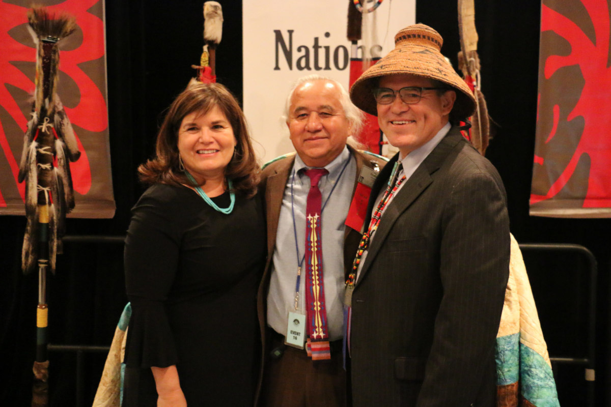Jacqueline Pata, Robert Holden and former NCAI president Brian Cladoosby at a National Congress of American Indians event in 2016.