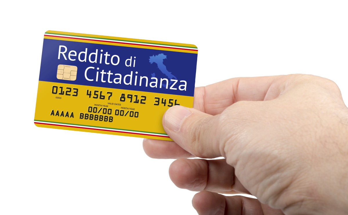 Credit card with the inscription in Italian: Reddito di Cittadinanza, which means Citizen's Basic Income, the new law introduced in Italy. The concept of Universal Basic Income.