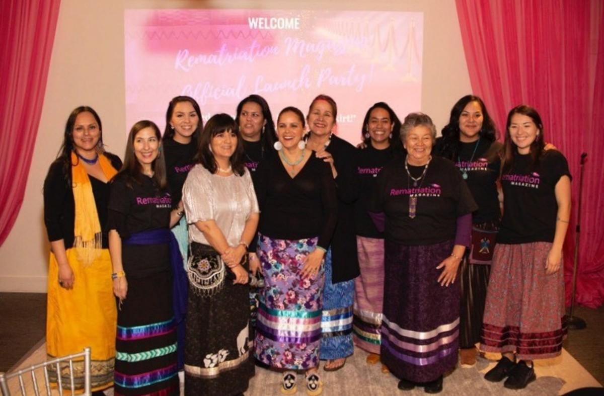 Michelle Schenandoah (center) stands with her Rematriatyion Magazine team and volunteers at the launch in Syracuse. During the event, Schenandoah also acknowledged all 180 participants for their support. (Photo: Jessica Sargent, Akwesasne Mohawk)