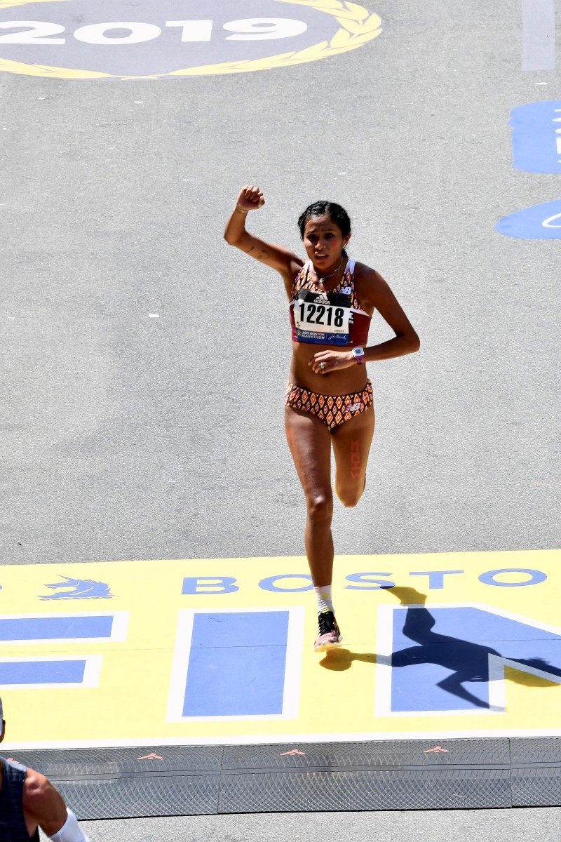 Jordan Marie Daniel makes an emotional finish at the Boston marathon after praying for one MMIW name at each of the courses' 26 miles. (Courtesy Boston Athletic Association)