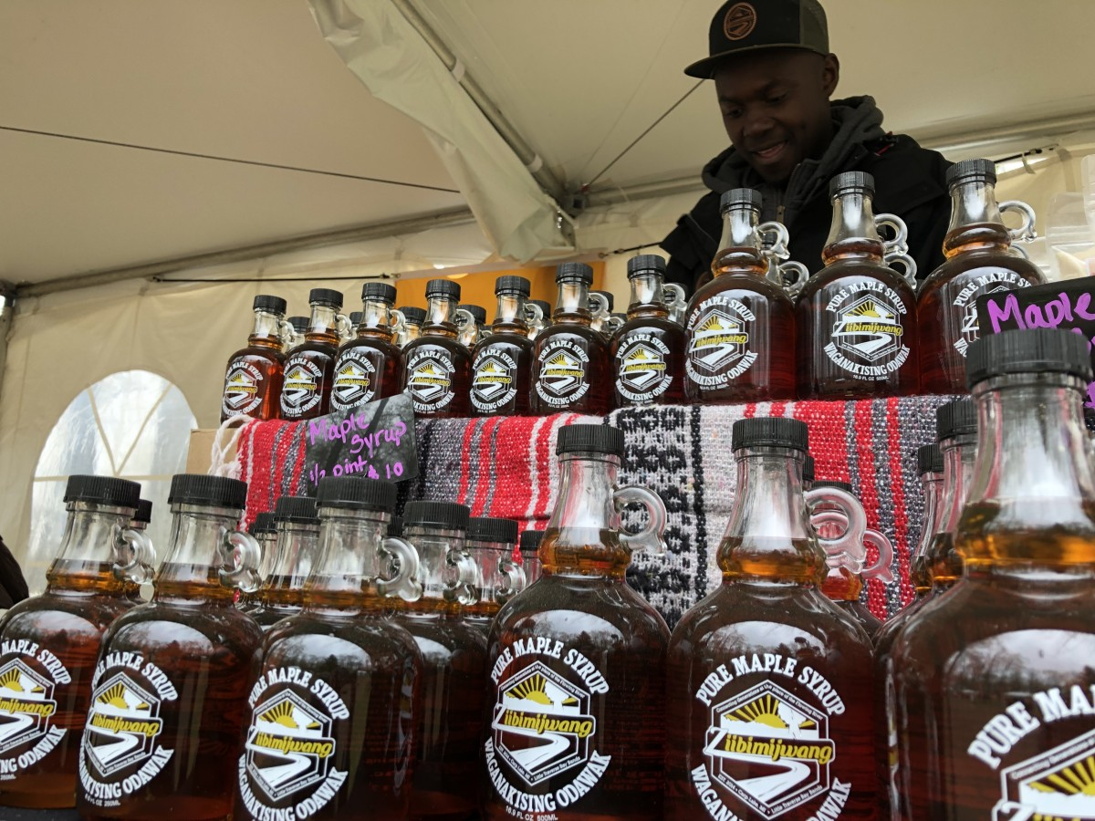 Bottles of tribal-made maple syrup cover Ziibimijwang's booth at the Intertribal Food Summit. (Photo by C.A. Printup).
