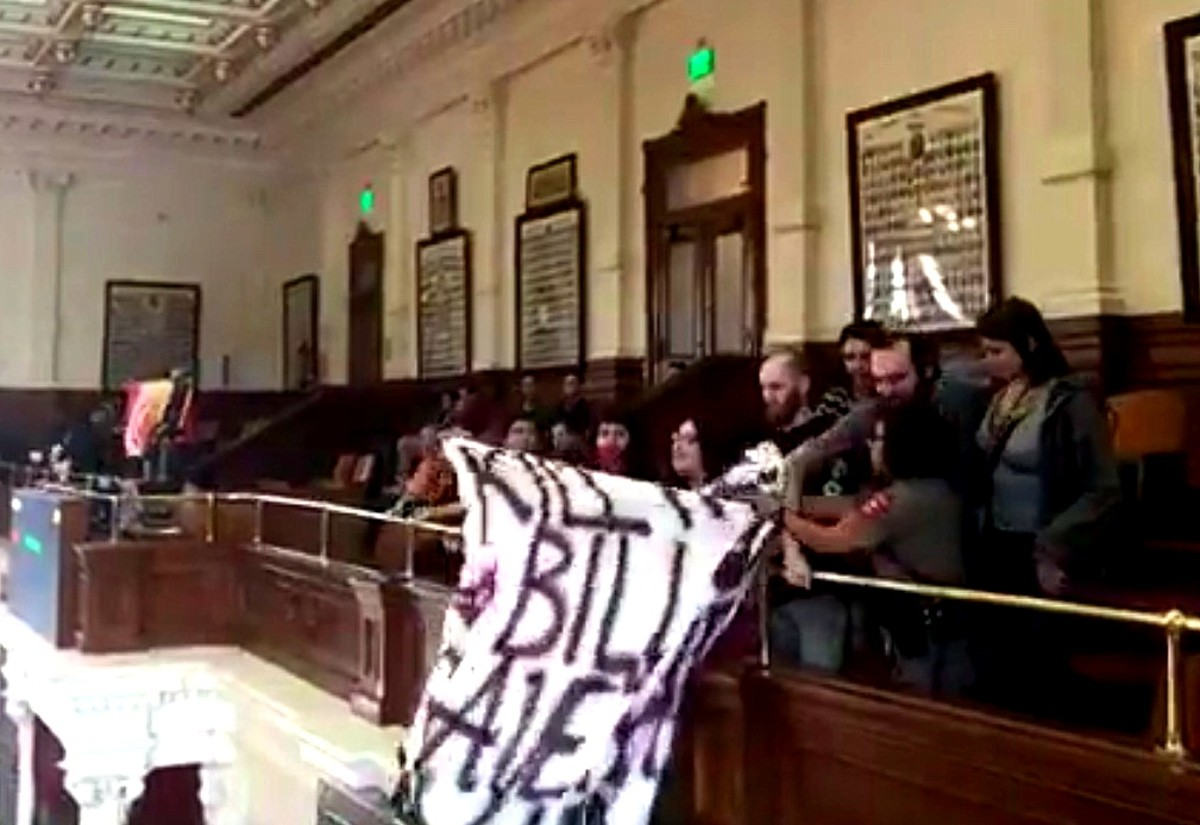 Society of Native Nations hold a 'Kill the Bill, Save the Land' banner inside the Texas State House of Representatives. Security quickly grabbed ahold of the banner to remove it. (Facebook screen capture)