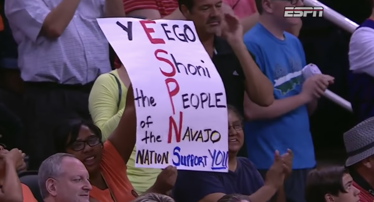Fans with Shoni Schimmel signs at the 2014 WNBA All-Star Game in Phoenix, July 19, 2014. (ESPN telecast screenshot)