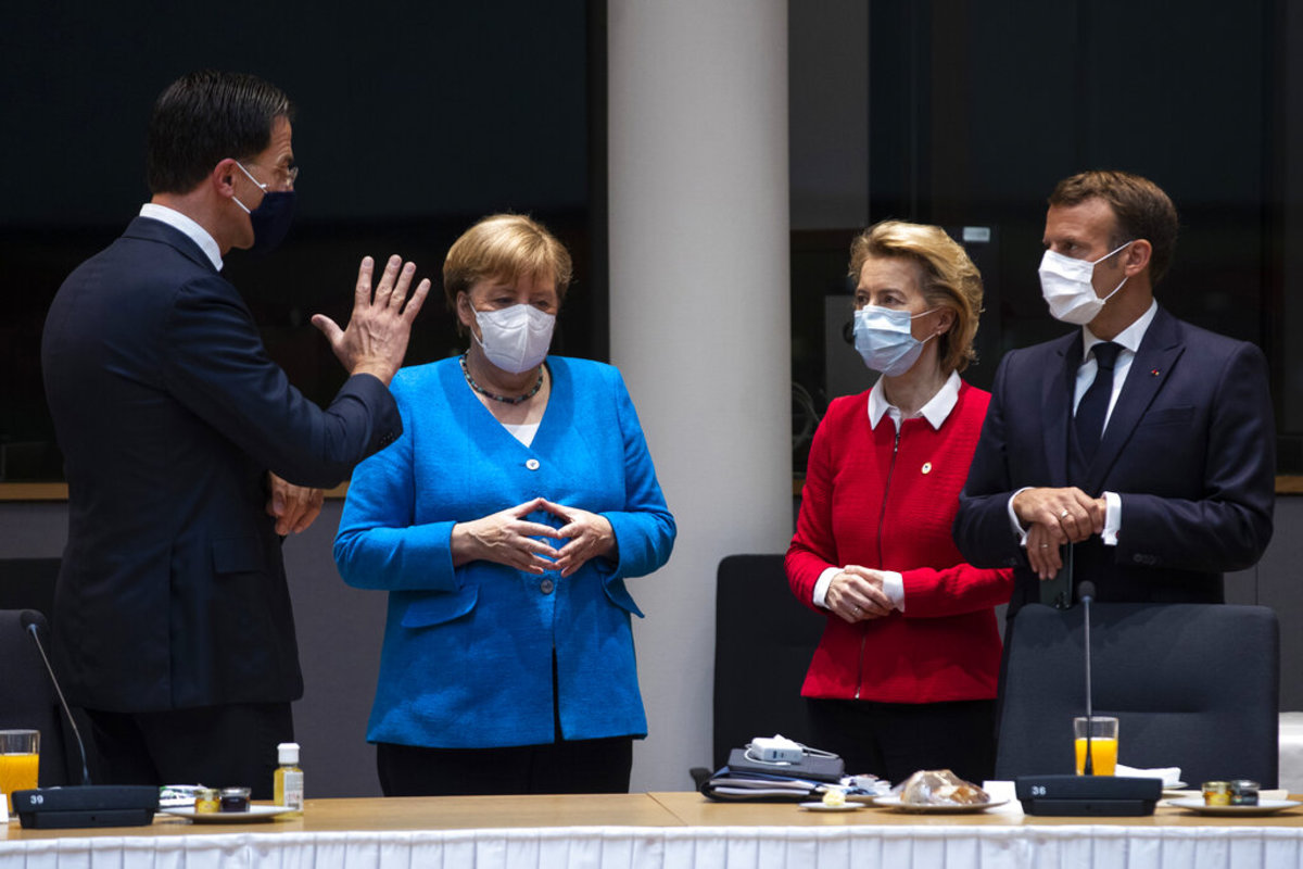 From left, Dutch Prime Minister Mark Rutte, German Chancellor Angela Merkel, European Commission President Ursula von der Leyen and French President Emmanuel Macron speak during a meeting on the sidelines of an EU summit in Brussels, Saturday, July 18, 2020. Leaders from 27 European Union nations meet face-to-face for a second day of an EU summit to assess an overall budget and recovery package spread over seven years estimated at some 1.75 trillion to 1.85 trillion euros. (AP Photo/Francisco Seco, Pool)