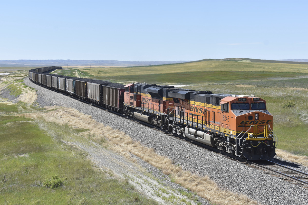 A BNSF Railway train hauling carloads of coal from the Powder River Basin of Montana and Wyoming is seen east of Hardin, Mont., on July 15, 2020. A coalition of states is renewing its push to stop the Trump administration from selling coal from public lands. (AP Photo/Matthew Brown)
