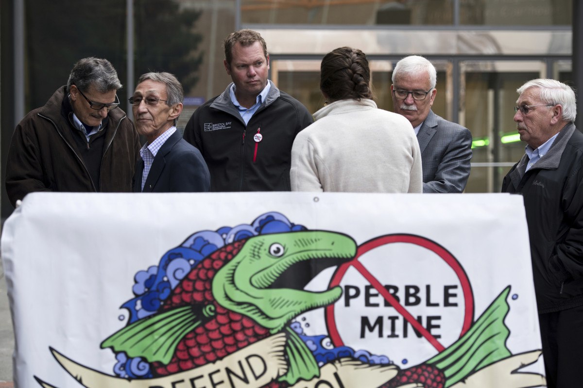 A broad coalition of Native and non-Native organizations oppose the Pebble Project. Shown here from left, Bristol Bay Reserve Association Board member Mike LaRussa, Bristol Bay Native Association President/CEO Ralph Andersen, Bristol Bay Regional Seafood Development Association Executive Director Andy Wink, United Tribes of Bristol Bay Deputy Director Lindsay Layland, Bristol Bay Economic Development Corporation President and CEO Norm Van Vactor, and Robin Samuelson of Bristol Bay Native Corporation, make statements at the Federal Courthouse in Anchorage, Alaska Tuesday Oct. 8, 2019. Critics of the Pebble Mine planned near headwaters of a major Alaska salmon fishery are suing the U.S. Environmental Protection Agency, saying EPA improperly withdrew proposed restrictions on development in that region. (Marc Lester/Anchorage Daily News via AP)