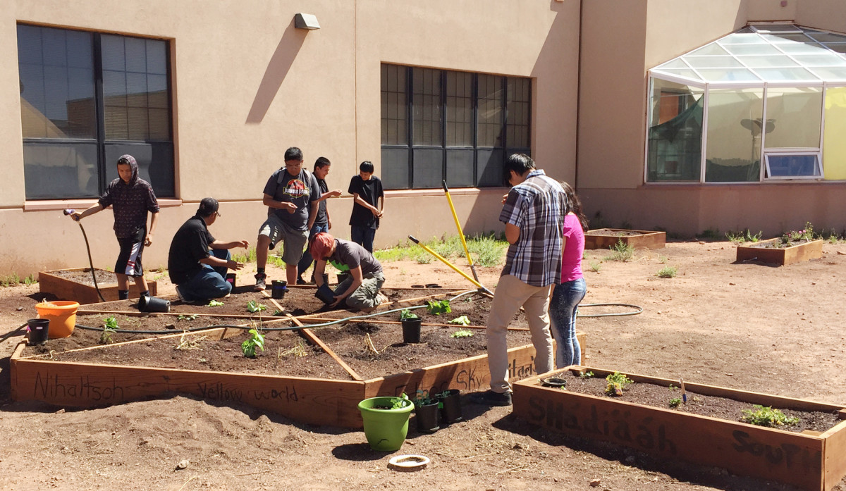 Navajo youth learn gardening in a raised bed, with support from Partnership With Native Americans. Amid COVID-19, Native Americans young and old are learning how to grow their own food again. (Photo courtesy of Partnership With Native Americans)