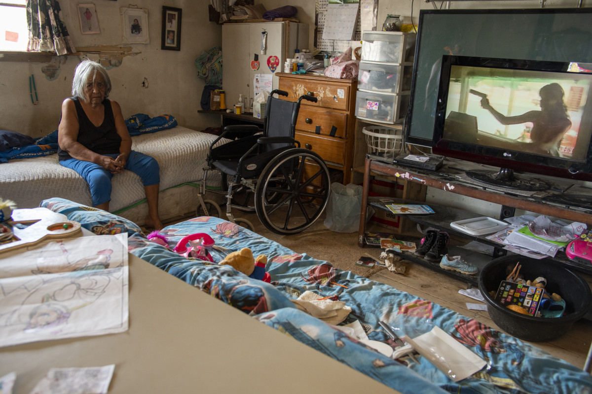 A housebound elderly woman watches television in her Navajo Nation house. (Photo by Don J. Usner/Searchlight NM)
