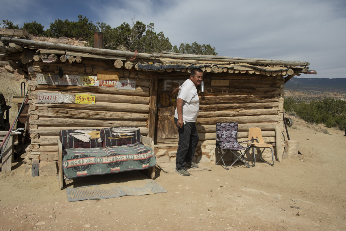 Edison Johnson steps outside his home on the Navajo Nation, south of Shiprock. (Photo by Don J. Usner/Searchlight NM)