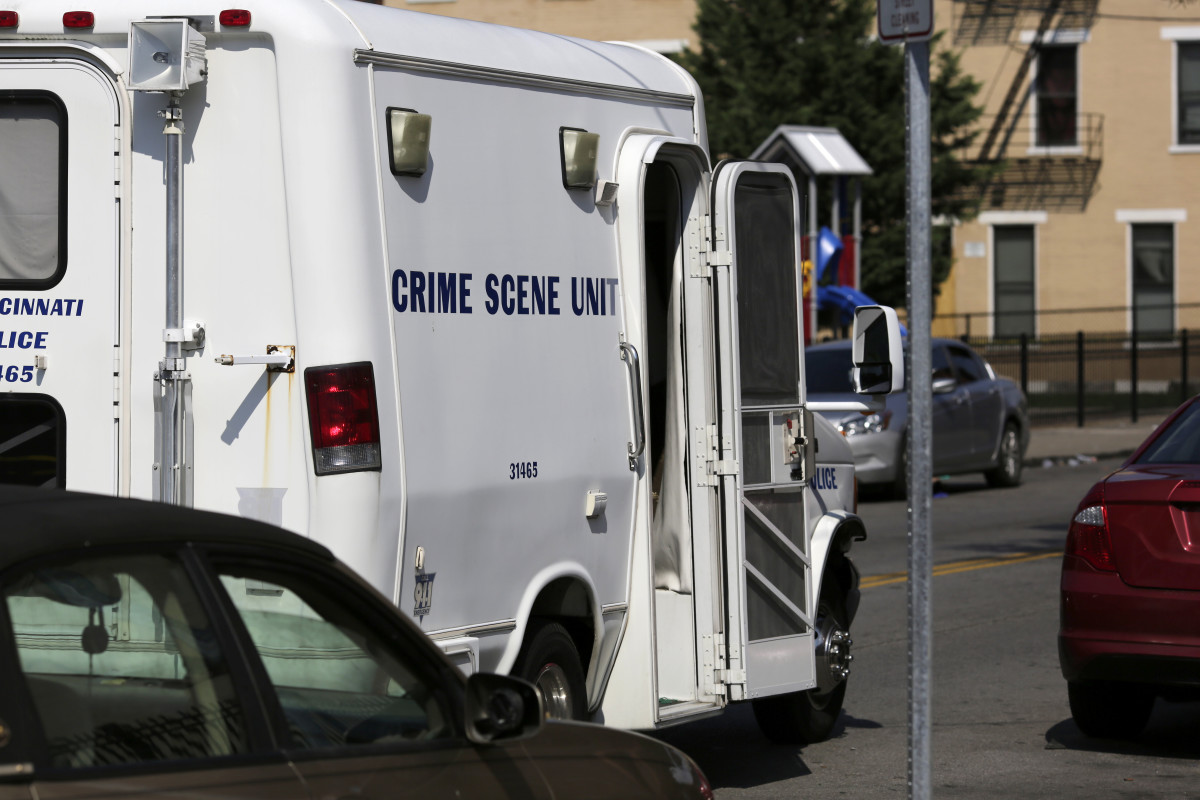 The Cincinnati Police crime scene unit is parked at the scene of a mass shooting near Grant Park on McMicken Avenue in the Over-the-Rhine neighborhood of Cincinnati on Sunday, Aug. 16, 2020. Police in Cincinnati said multiple people were shot and several killed as gunfire erupted in several places around the city overnight. (Sam Greene/The Cincinnati Enquirer via AP)