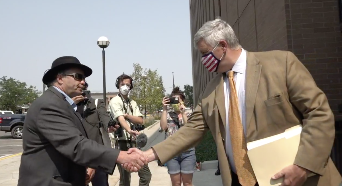 Mark Tilsen drops off petitions to Pennington County State's Attorney Mark Vargo on Aug. 21, 2020. The petitions are related to the charges against the Black Hills treaty defenders, which include Tilsen's son, Nick. (Photo via NDN Collective Facebook video)