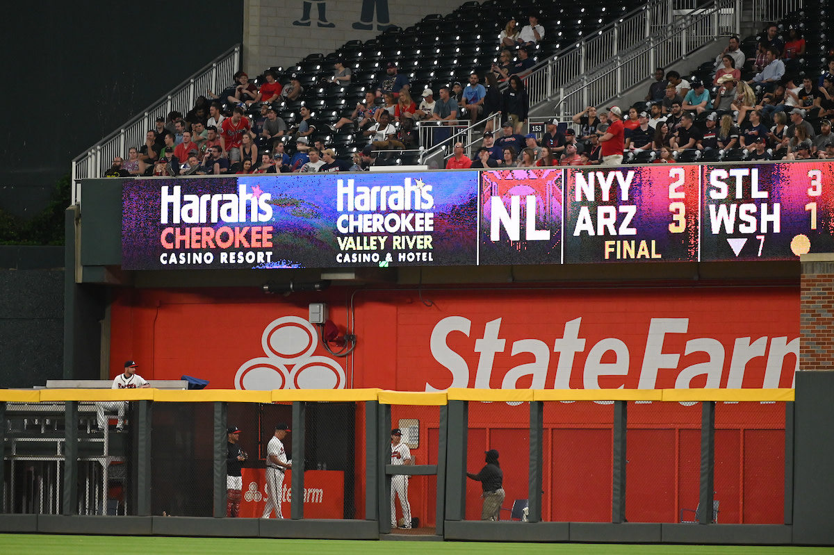 Harrah's Cherokee casinos, owned by the Eastern Band of Cherokee Indians, are sponsors for the Atlanta Braves. This shows the signage during the Braves game at home against the San Diego Padres May 1, 2019. (Photo by Adam Hagy for the Atlanta Braves)