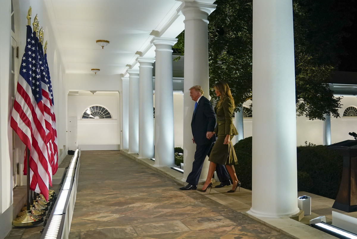First lady Melania Trump and President Donald Trump walk along the Colonnade after she spoke on the second night of the Republican National Convention from the Rose Garden of the White House, Tuesday, Aug. 25, 2020, in Washington. (AP Photo/Evan Vucci)