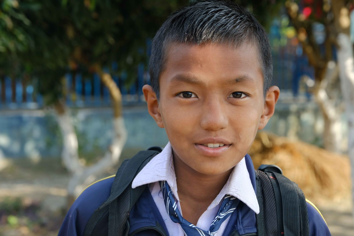 Shiva, 11, is Bena Shrestha's son. He now lives outside Jhapa prison and attends school with the help of Prisoner's Assistance Nepal. (Photo by Mary Annette Pember)