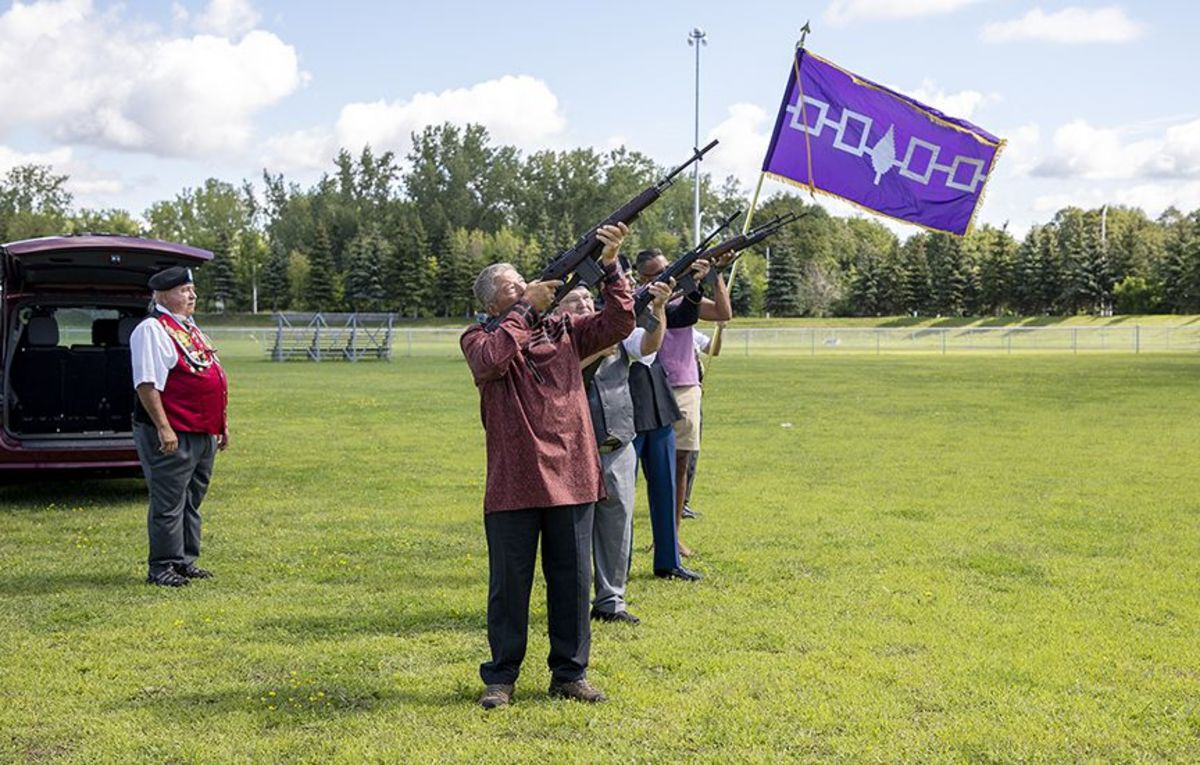 Members of the Royal Canadian Legion Mohawk Brand 219 conduct a rifle salute for Norton. (Photo by Greg Horn/Iorì:wase)