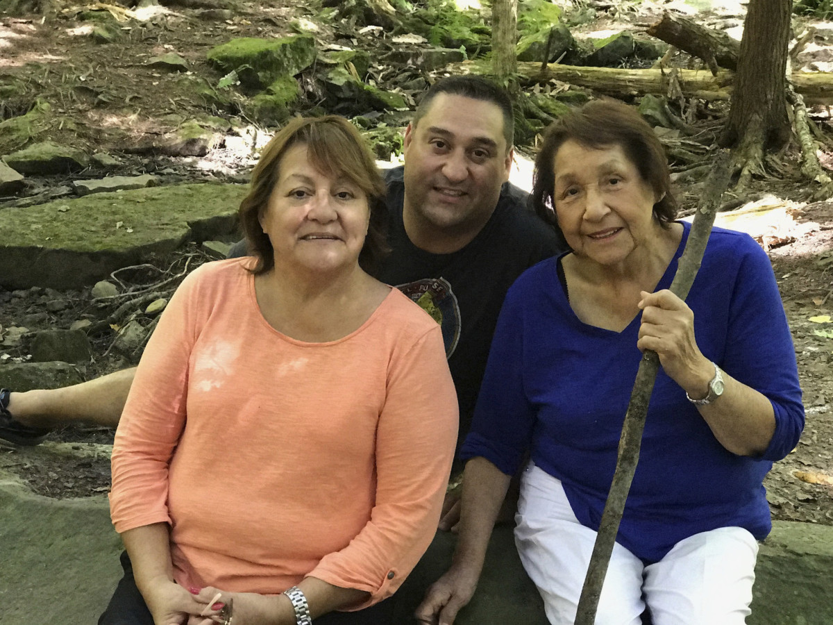 In this 2017 photo provided by Marc Papaj, he poses for a photo with his grandmother Norma Kennedy, right, and his mother, Diane Kennedy, at Allegany State Park, in New York state. (Courtesy of Keiko Papaj via AP)