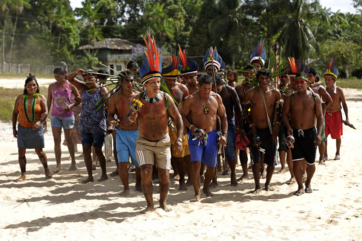 The Tenetehara Indigenous community holds a festival in the Alto Rio Guama Indigenous Reserve, where they have enforced six months of isolation during the new coronavirus pandemic, near the city of Paragominas, Brazil, Monday, Sept. 7, 2020. The Indigenous group, also known as Tembe, are celebrating and giving thanks that none of their members have fallen ill with COVID-19, after closing their territory from outsiders since March. (AP Photo/Eraldo Peres)
