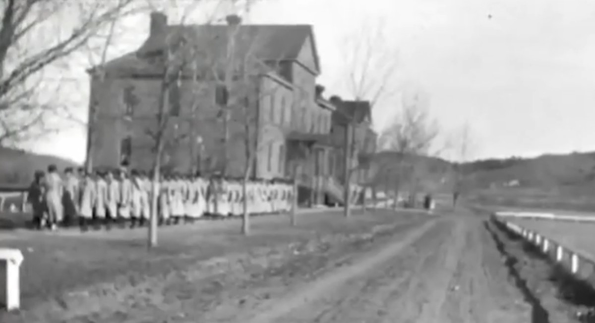 Students line up outside the Rapid City Indian Boarding School in this undated photo. The school operated from 1898 until 1933. After the school shut down the federal government distributed some 1,200 acres of school land to the city, the local school district, the national guard and churches — but none to Native Americans. (Photo courtesy of the South Dakota State Historical Society)
