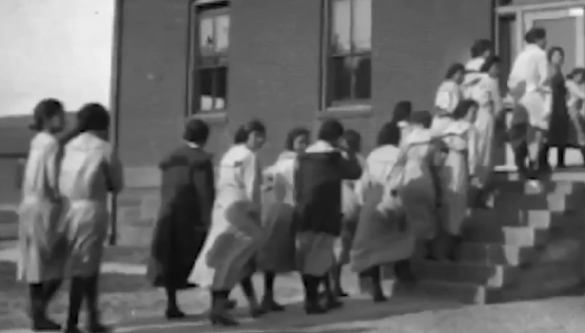 "Students line up to enter a building on the campus of the Rapid City Indian Boarding School in this undated photo. The school operated from 1898 until 1933. Disputes over the school's land after it closed have ""proven to be an ongoing, nagging issue that … is not going away,"" said Rapid City Mayor Steve Allender. (Photo courtesy of the South Dakota State Historical Society)"