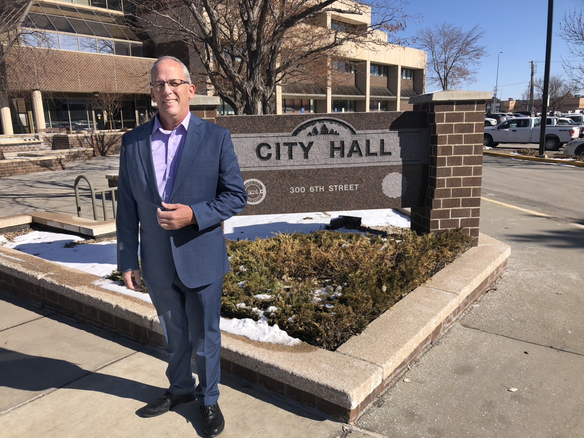 "Rapid City, S.D., Mayor Steve Allender stands in front of City Hall. Allender has been in talks with Native community members about settling some long running land ownership questions on the west side of town. ""We have come to a conceptual recommendation involving a 20- or 30-year plan to benefit the Native community as well as the community at large,"" Allender said. (Photo by Stewart Huntington)"
