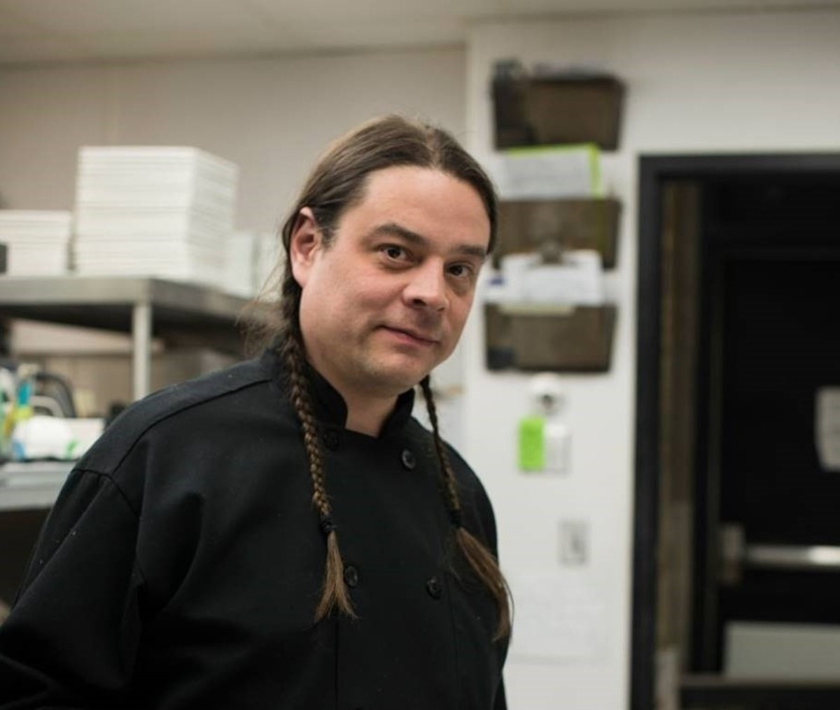 Sean Sherman, the Sioux Chef, plates dessert at an exhibition in Fargo, North Dakota. Sherman wants to offer insects on the menu of a new restaurant he is planning to open in Minneapolis. (Photo courtesy of the Sioux Chef)