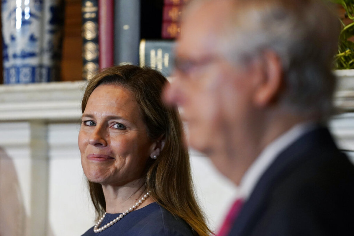 Supreme Court nominee Judge Amy Coney Barrett looks over to Senate Majority Leader Mitch McConnell of Ky., as they meet with on Capitol Hill in Washington, Tuesday, Sept. 29, 2020. (AP Photo/Susan Walsh, POOL)