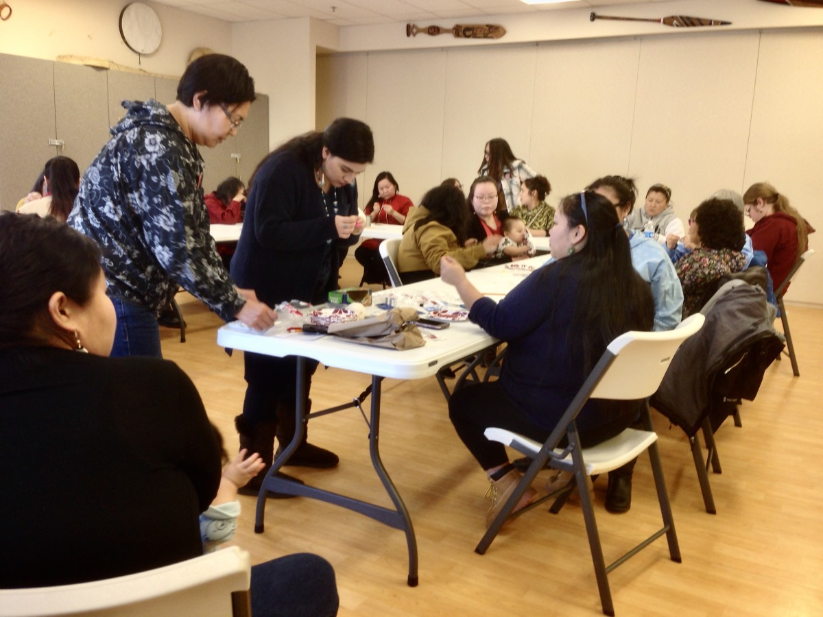A beading class held as part of a day of healing over Missing and Murdered Indigenous Women and Girls at the Alaska Native Heritage Center (Photo by Joaqlin Estus, Feb. 1, 2020)