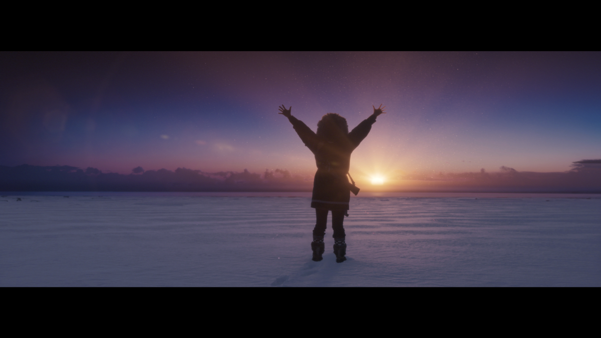 """The main character of the short film """"Ada Blackjack Rising"""" is played by Adelaine Aklaasiaq Ahmasuk, Inupiaq, show here greeting the first sunrise after months of darkness in an Arctic winter. (Photo by Michael Conti, courtesy of 3 Peaks)."""