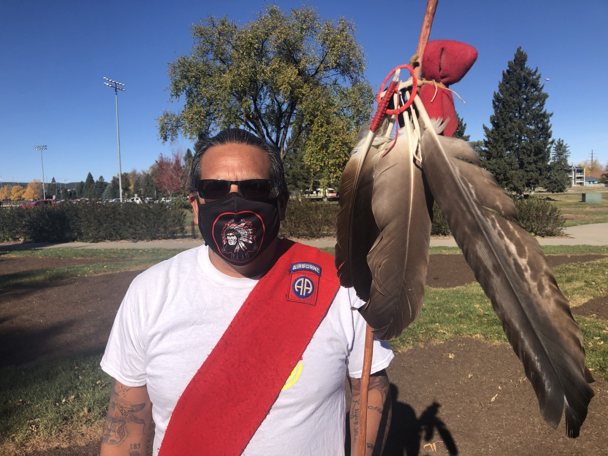 """In this Monday, Oct. 12, 2020, photo, John Old Horse stands ready to lead marchers in Rapid City, South Dakota. Indigenous People's Day is a """"very important day to acknowledge the accomplishments of our people,"""" said Old Horse. """"And also to remember the things that aren't so great in our past and heal our community."""" (Photo by Stewart Huntington)"""