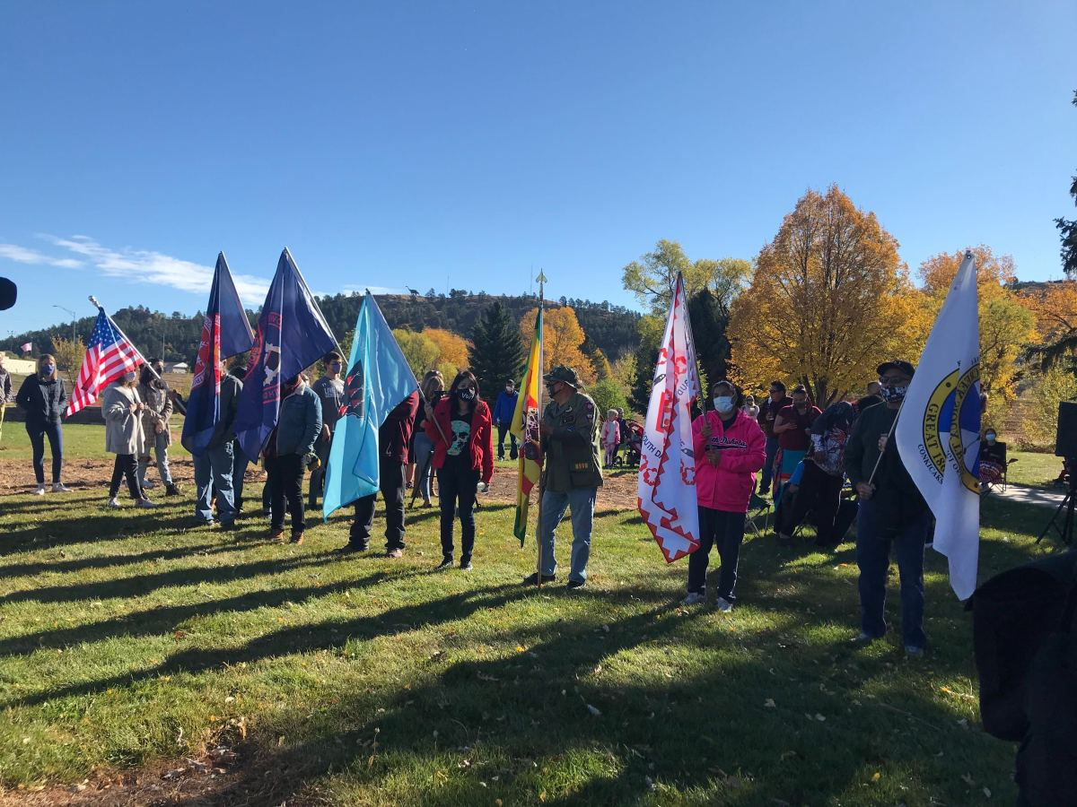 This Monday, Oct. 12, 2020, photo shows people taking part in a memorial walk honoring children who died while attending the Rapid City Indian Boarding School, which operated from 1898 to 1933. (Photo by Randi Oyan)