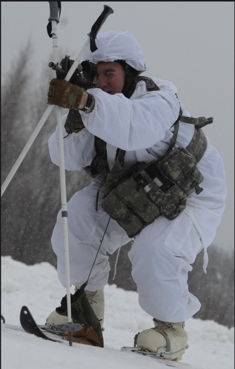 Arctic military - Spartans conduct Arctic airborne ops - Army Staff Sgt. Bruce Henderson, a native of Keystone Heights, Fla., assigned the 1st Squadron (Airborne), 40th Cavalry Regiment, 4th Infantry Brigade Combat Team (Airborne), 25th Infantry Division, part of U.S. Army Alaska, takes aim with his M4 carbine on Malemute drop zone at Joint Base Elmendorf-Richardson, Alaska, Dec. 12, 2013. This is the first Arctic airborne operation for the brigade since its redeployment from Afghanistan last year, and the purpose of this training event is to further validate the unit's rapid insertion capability into Arctic conditions. (U.S. Air Force photo by Justin Connaher/Released)  Date Taken:12.12.2013