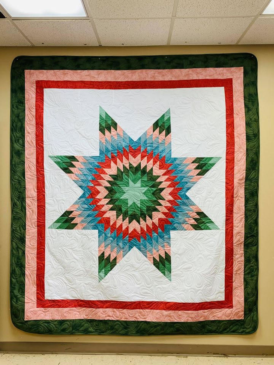 """Pictured: This holiday season, CRYP is raffling off """"Sugar Plum,"""" an authentic Lakota star quilt hand-crafted by Cheyenne River Lakota artist Bonnie LeBeaux, to raise funds to support its Wo Otúh'an Wi Toy Drive."""